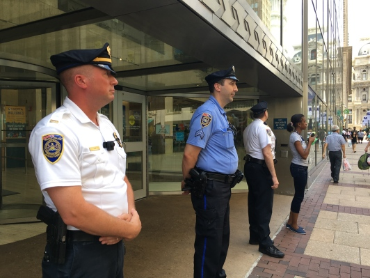Transit Police keep watch as protestors march down Market Street.